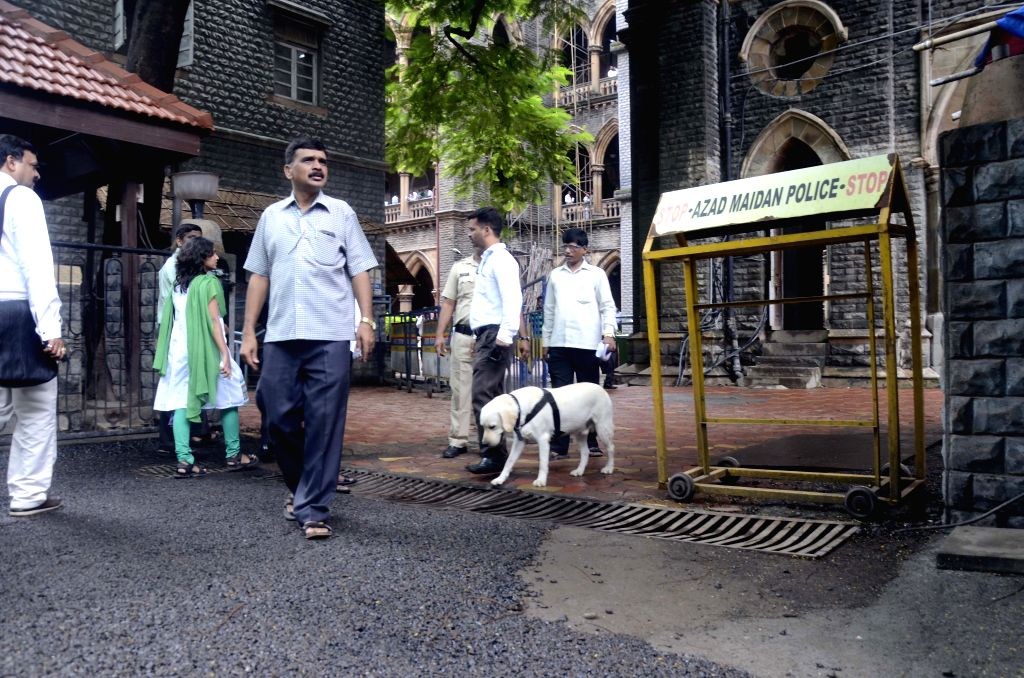Sniffer dogs were brought at the Bombay high court to search a possible bomb in Mumbai on Aug 10, 2015. The Bombay high court received an anonymous call saying there was a bomb in Justice ...