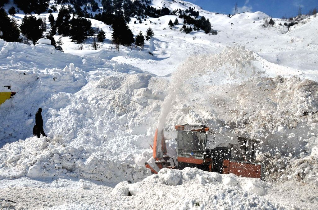 Snow clearing operations underway on Srinagar-Jammu highway in Banihal on Feb 11, 2019.