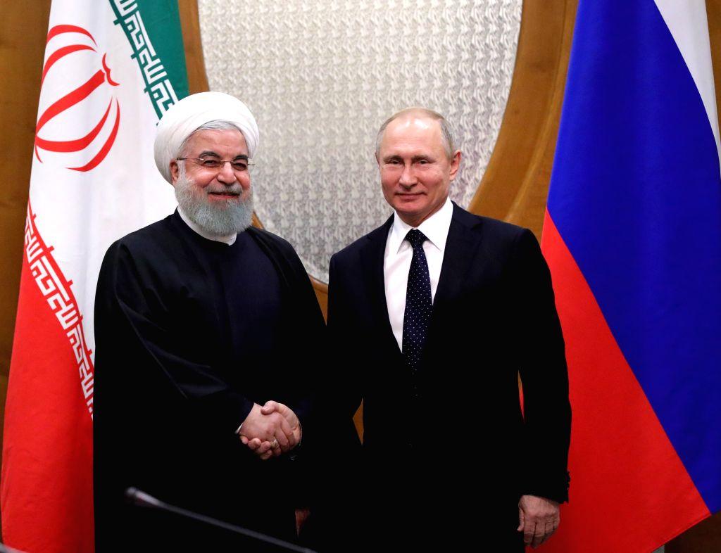 SOCHI, Feb. 14, 2019 - Russian President Vladimir Putin (R) shakes hands with President of Iran Hassan Rouhani during a meeting in Sochi, Russia, Feb. 14, 2019. - Hassan Rouhani
