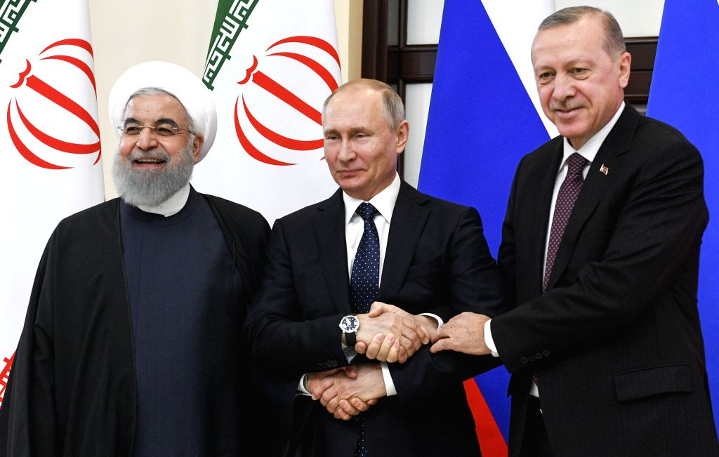 SOCHI, Feb. 15, 2019 - Russian President Vladimir Putin (C) shakes hands with Iranian President Hassan Rouhani (L) and Turkish President Recep Tayyip Erdogan during their meeting in Sochi, Russia, on ... - Hassan Rouhani