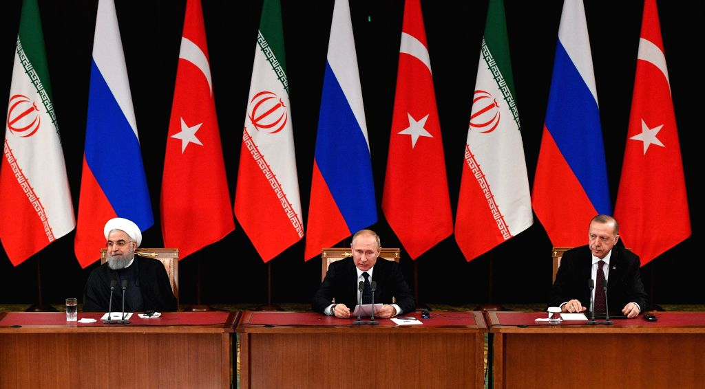 SOCHI, Feb. 15, 2019 - Russian President Vladimir Putin (C) speaks during a news conference with Iranian President Hassan Rouhani (L) and Turkish President Recep Tayyip Erdogan in Sochi, Russia, on ... - Hassan Rouhani