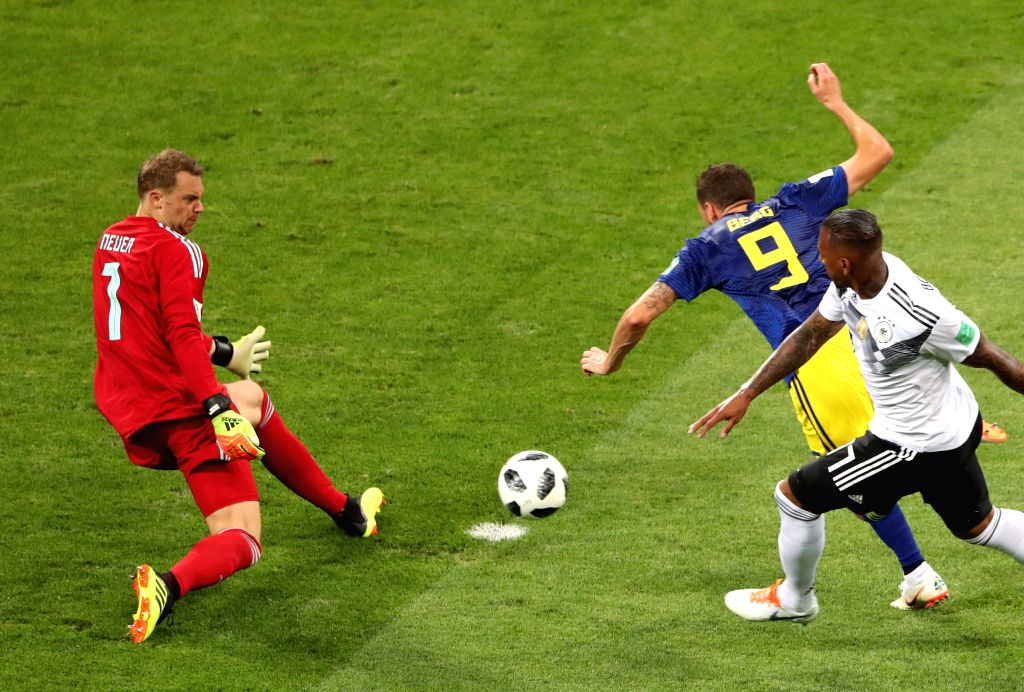 SOCHI, June 23, 2018 - Goalkeeper Manuel Neuer of Germany (L) defends as Marcus Berg of Sweden (C) shoots during the 2018 FIFA World Cup Group F match between Germany and Sweden in Sochi, Russia, ...