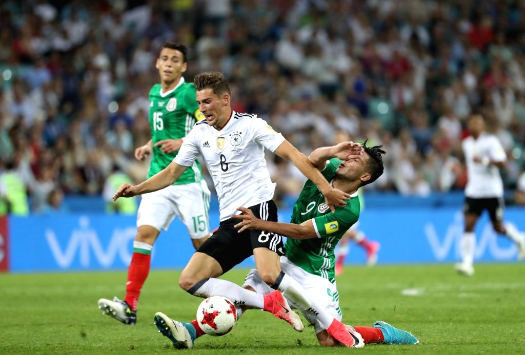 SOCHI, June 30, 2017 - Leon Goretzka (front L) of Germany vies with Raul Jimenez (front R) of Mexico during the semifinal match of the 2017 FIFA Confederations Cup in Sochi, Russia, June 29, 2017. ...