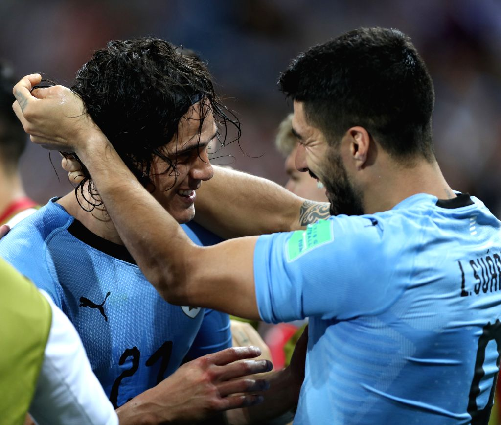 SOCHI, June 30, 2018 (Xinhua) -- Edinson Cavani (L) of Uruguay celebrates scoring with Luis Suarez during the 2018 FIFA World Cup round of 16 match between Uruguay and Portugal in Sochi, Russia, June 30, 2018. (Xinhua/Fei Maohua/IANS)
