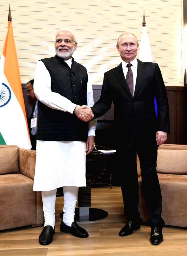 :Sochi: Prime Minister Narendra Modi meets Russian President Vladimir Putin in Sochi, Russia on May 21, 2018. (Photo: IANS/MEA).