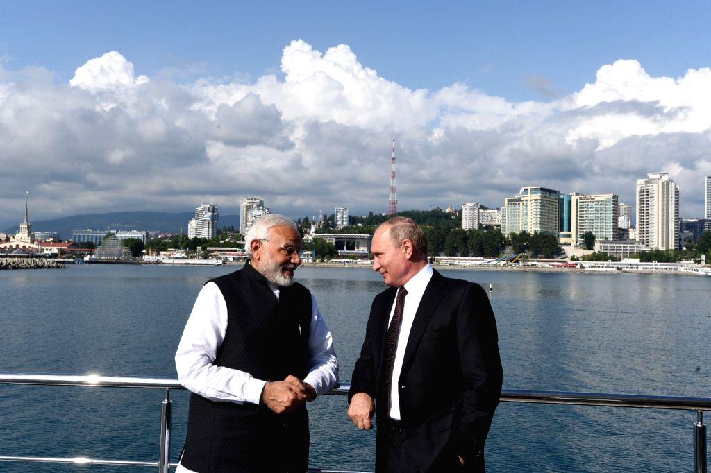 :Sochi: Prime Minister Narendra Modi with the Russian President Vladimir Putin in Sochi, Russia on May 21, 2018. (Photo: IANS/PIB).
