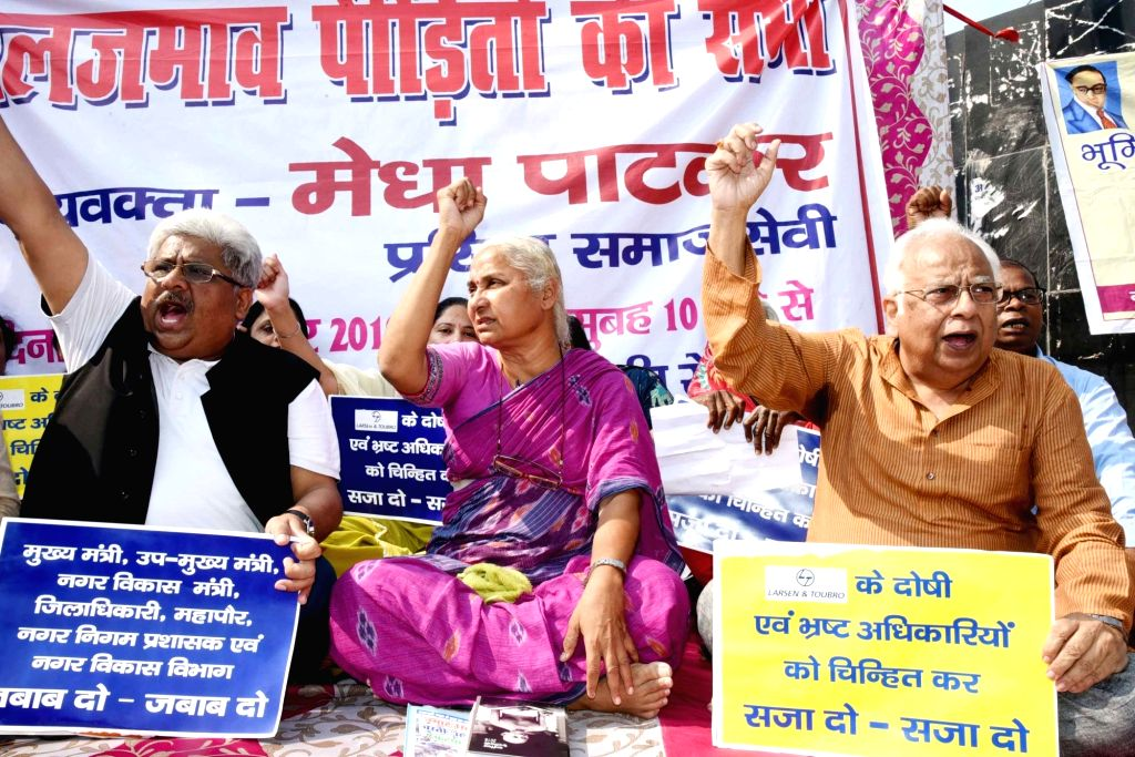 Social activist and 'Narmada Bachao Andolan' founding member Medha Patkar stage a demonstration against water accumulation in various places in Patna on Nov 12, 2019.