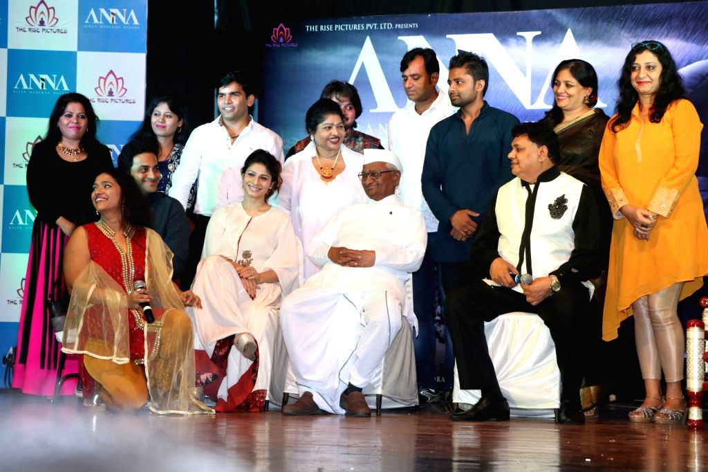 Social activist Anna Hazare and actress Tanishaa Mukerji during the poster launch of film Anna in Mumbai on June 27, 2016. - Tanishaa Mukerji