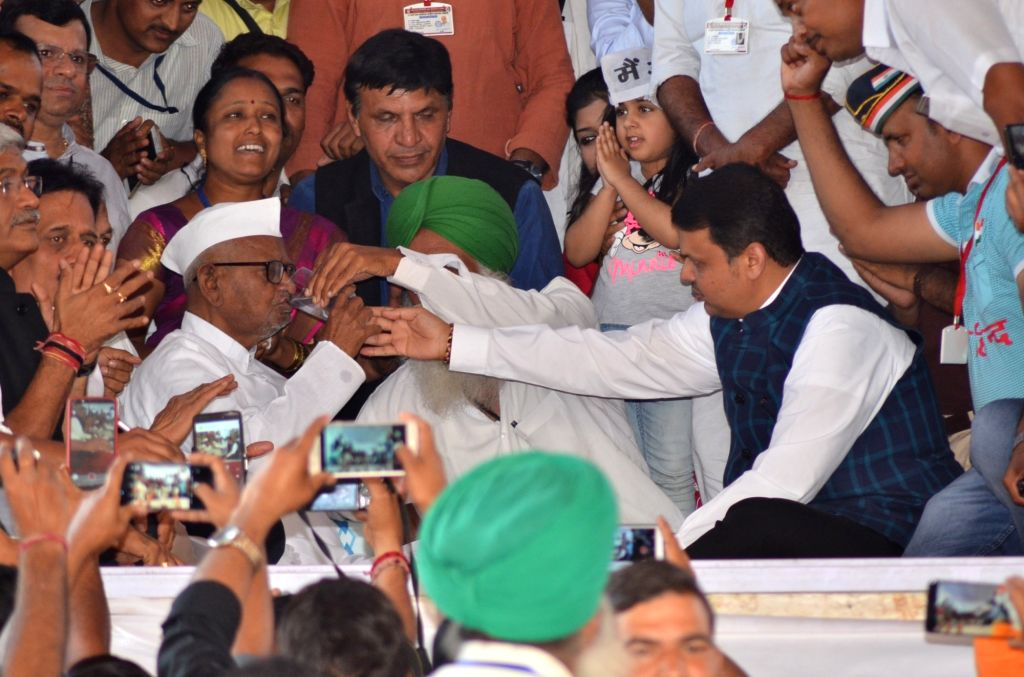 Social activist Anna Hazare breaks his fast and called off his hunger strike after the Central government sought six months to deal with his demands on fair crop prices, Lokpal appointment ... - Devendra Fadnavis