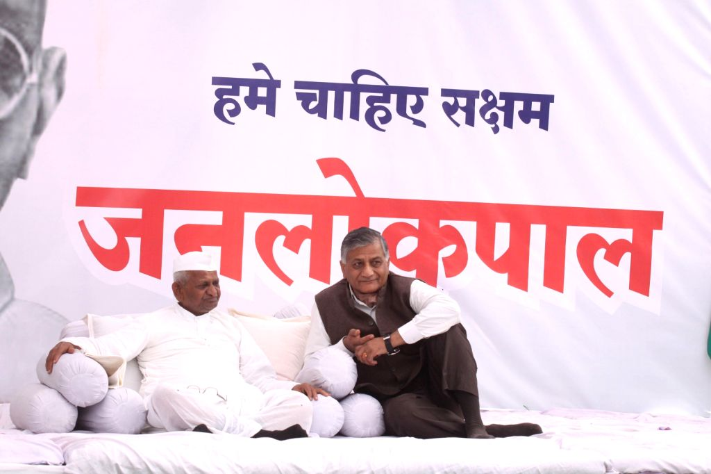 Social Activist Anna Hazare with General V K Singh on the fourth day of his indefinite hunger strike to press for passage of Jan Lokpal Bill in Parliament at Ralegaon Siddhi on Dec.13, 2013.