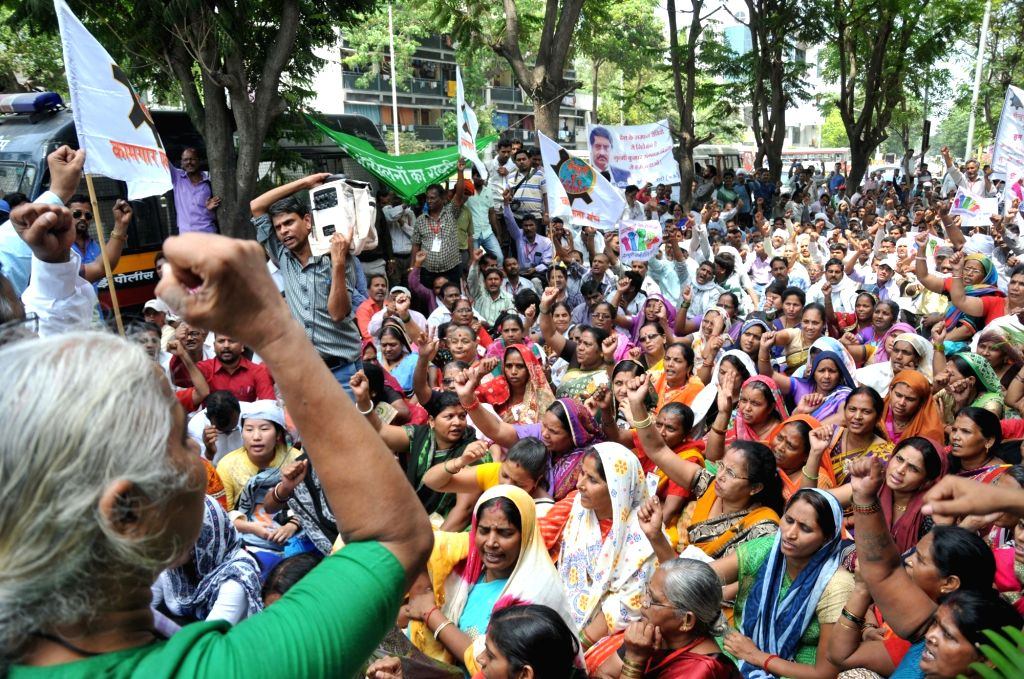 Social activist Medha Patkar along with tribals from Madhya Pradesh stage a demonstration outside the Century Bhavan in Mumbai on April 6, 2018.