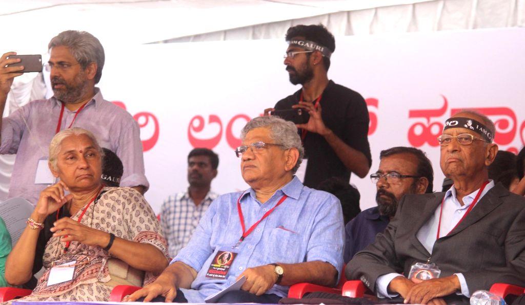 Social activist Medha Patkar and CPI(M) General Secretary Sitaram Yechury during a protest rally against the killing of journalist turned activist Gauri Lankesh at Central College ... - Sitaram Yechury