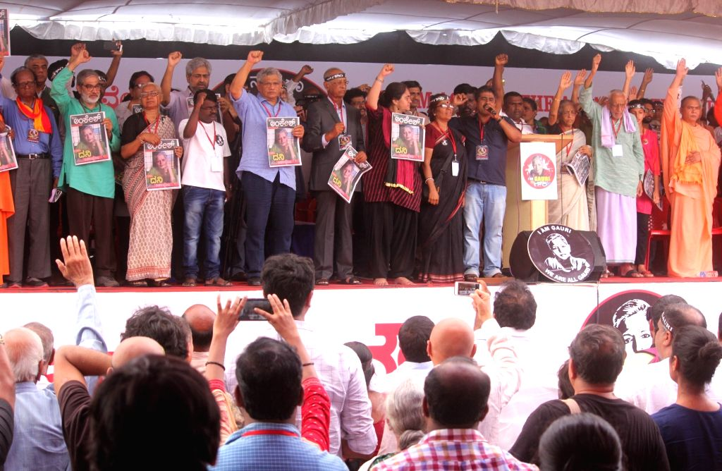 Social activist Medha Patkar and CPI(M) Secretary Sitaram Yechuri during a protest rally against the killing of journalist turned activist Gauri Lankesh at Central College Ground in ...