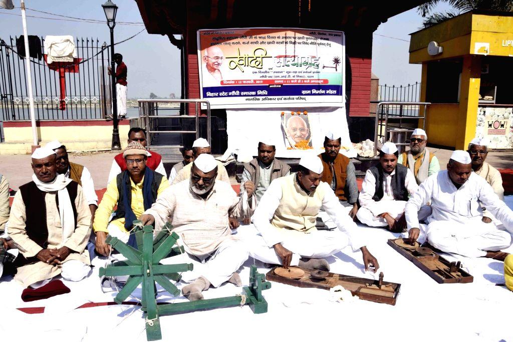 Social activist Vinod Ranjan and others participate in Khadi Satyagrah at Gandhi Ghat in Patna on Feb 12, 2019.