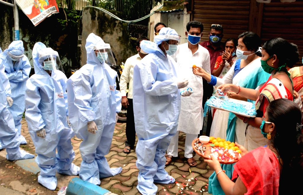 Social activists felicitate health workers and distribute sweets and masks among them on the occasion of Raksha Bandhan amid COVID-19 pandemic, in Kolkata on Aug 3, 2020.