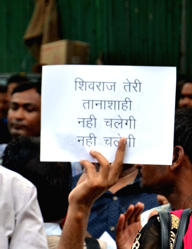 Social activists participate in a demonstration against removing and arrest of Narmada Bachao Andolan protesters by Madhya Pradesh government in front of Madhya Pradesh Bhawan in New Delhi ...