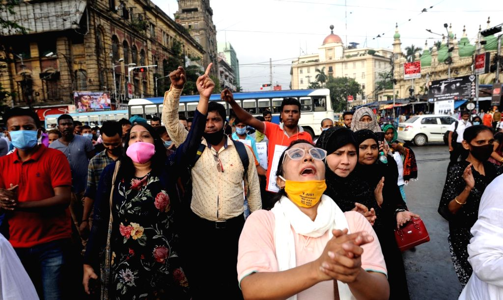 Social activists participate in a protest rally demanding to save the federal structure to resist further division of Bengal, repeal farm laws 2020, payment of  GST compensation to the State ...