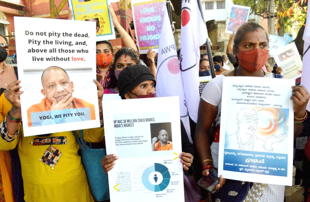 Social activists protest against the BJP-led Government in Karnataka mulling a strict law against 'Love Jihad' - inter-religious marriages involving Hindu women; in Bengaluru on Dec 1, ...