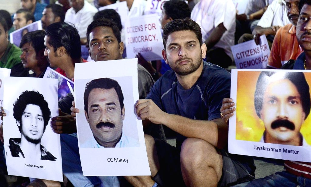 Social activists stage a demonstration against attack on Social Activists in Kerala in Bengaluru, on Sept 10, 2016.