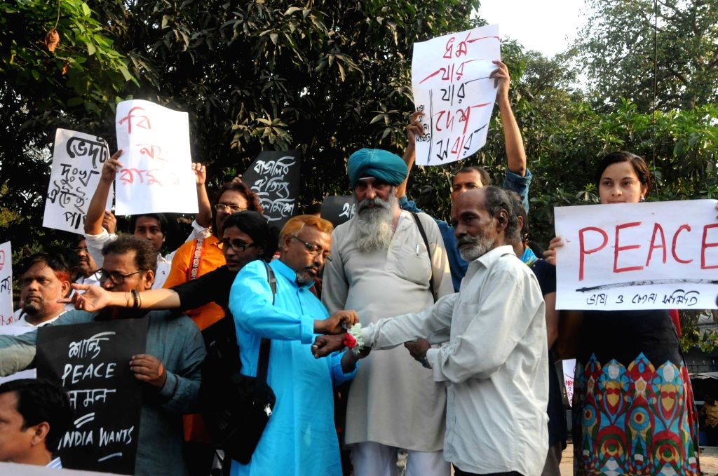 Social activists stage a demonstration against violence in West Bengal; in Kolkata on March 30, 2018.
