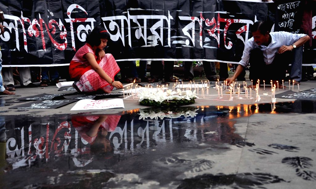 Social activists take out a candle march to condemn terror strike in Dhaka; in Kolkata on July 2, 2016.