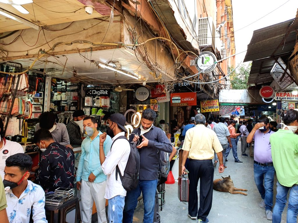 Social distancing norms go for a toss in Delhi markets.