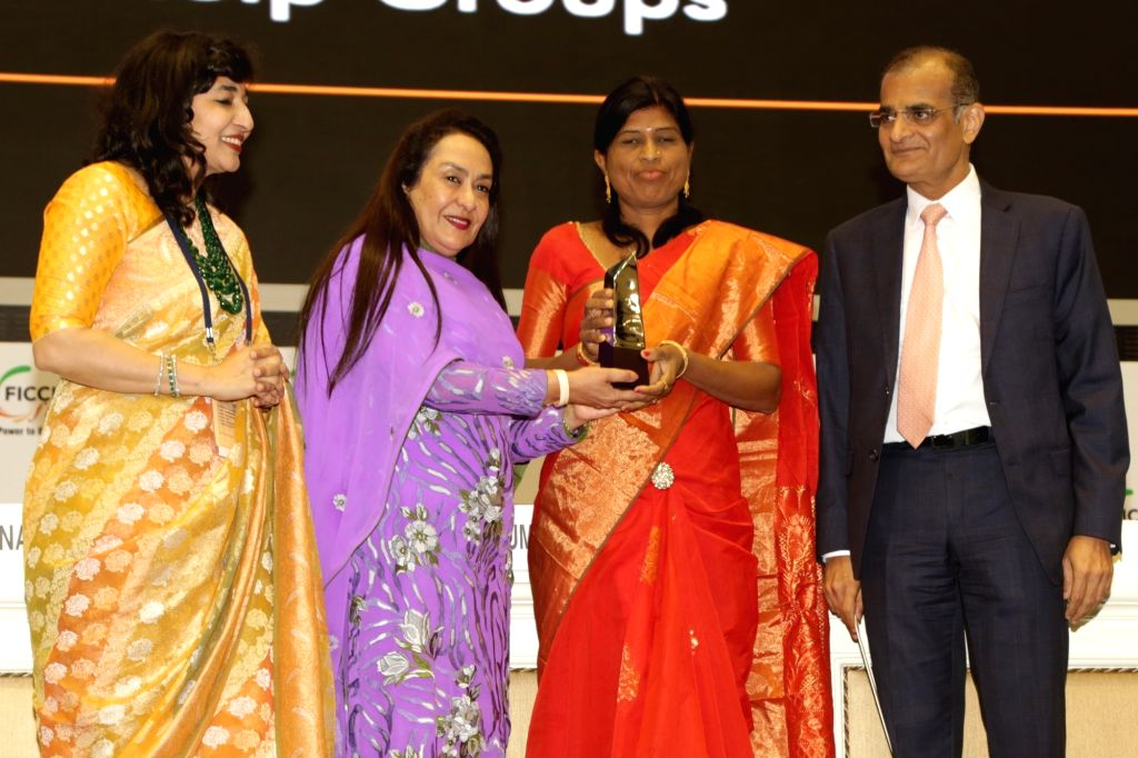 Social Entrepreneur Kamal Kumbhar receives the FLO Icon Award during 34th Annual Session of FICCI Ladies Organisation (FLO) at Vigyan Bhavan in New Delhi on April 5, 2018.