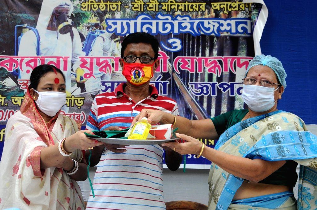 Social service organization 'Sree Sree Sati Matar Aswar' felicitates Covid Warriors in Kolkata on Aug 30, 2020.