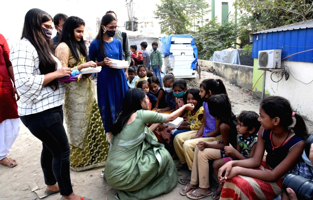 Social workers distribute gifts among slum children on the eve of Diwali, in Patna on Nov 13, 2020.