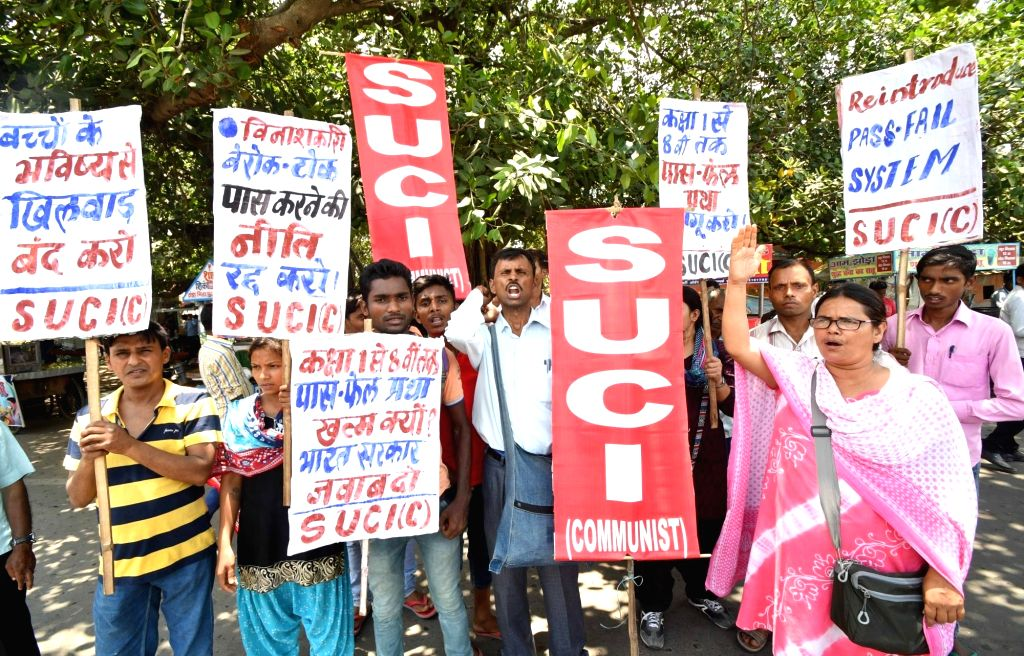 Socialist Unity Centre of India (Communist) activists stage a demonstration to press for their various demand, in Patna, on July 19, 2018.