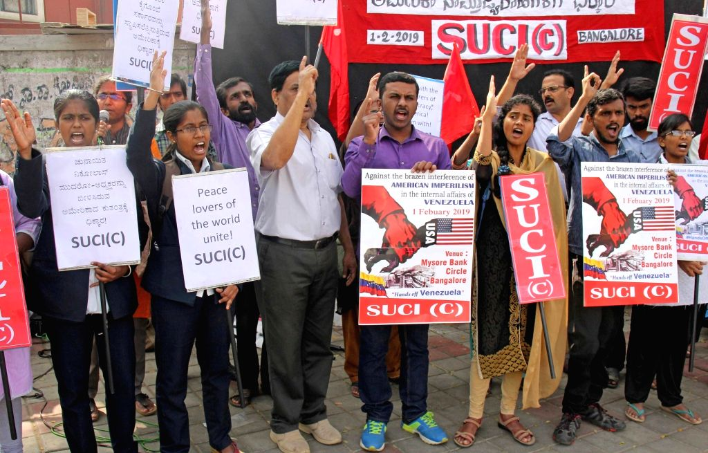 Socialist Unity Centre of India - Communist (SUCI-C) activists stage a demonstration against interference of America in the internal affairs of Venezuela, in Bengaluru on Feb 1, 2019.