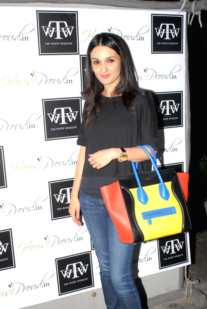 Socialite Anu Deewan during the preview of the latest Flower Power Collection at The White Window store in Mumbai, on July 31, 2014.
