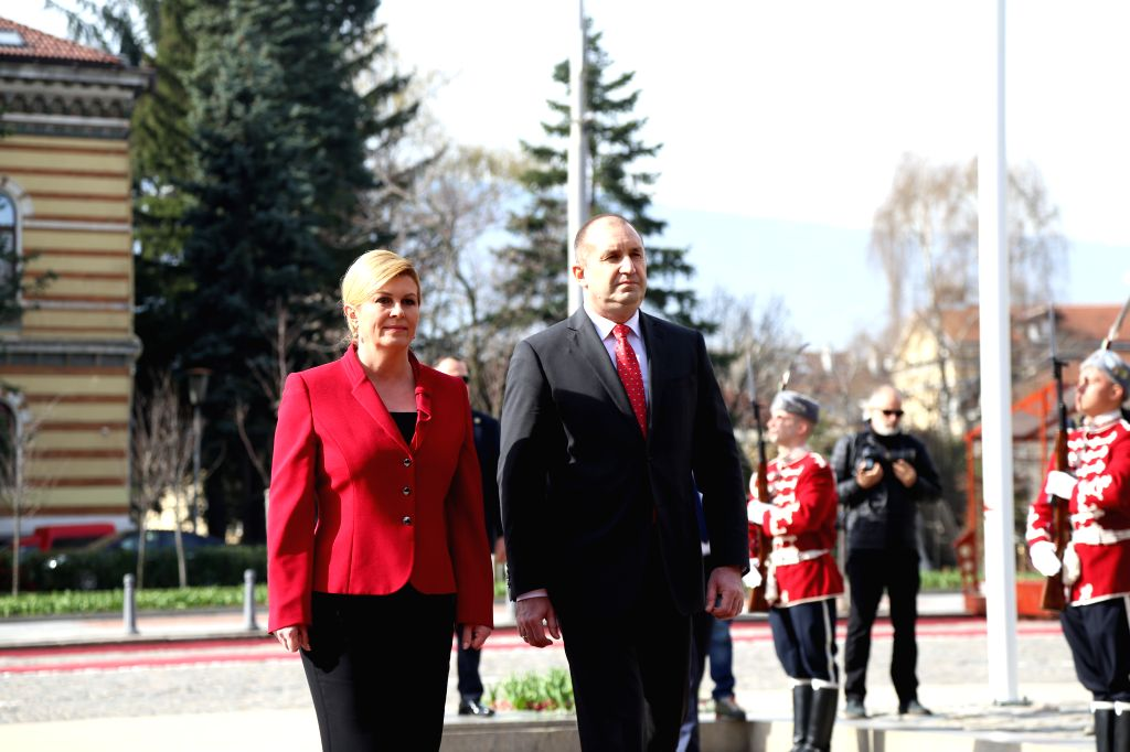 SOFIA, April 4, 2018 - Bulgarian President Rumen Radev (L, Front) and Croatian President Kolinda Grabar-Kitarovic (R, Front) inspect the guard of honor in Sofia, Bulgaria, on April 4, 2018. Bulgarian ...