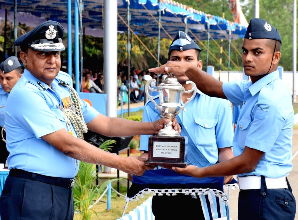 Software Development Institute Commandant Air Vice Marshal PKH Sinha presents the best all rounder trophy to leading Aircraftman AK Sharma, during the Passing out Parade at Air Force ...