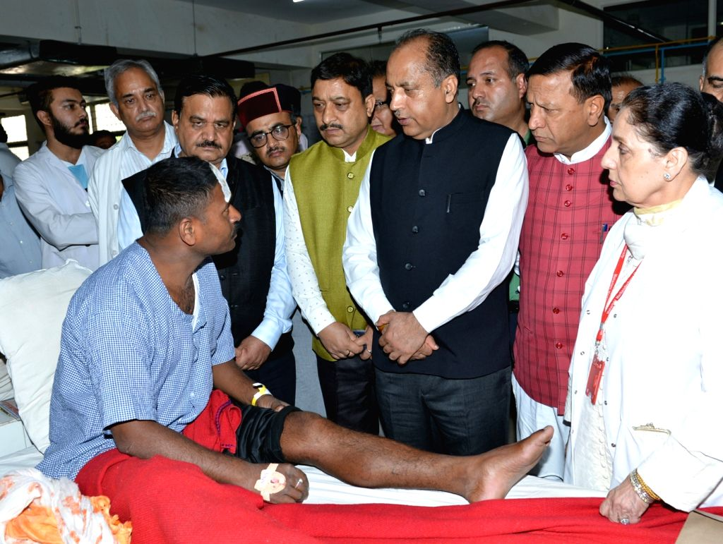 Solan: Himachal Pradesh Chief Minister Jai Ram Thakur meets one of the victims of a building collapse, receiving treatment at a hospital in Solan district on July 15, 2019. Eleven soldiers and a civilian were killed and 28 others rescued after a four - Jai Ram Thakur