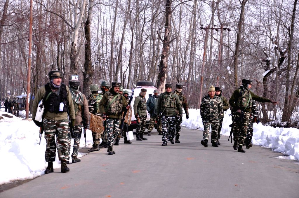 Soldiers at the site where a gunfight erupted between security forces and militants in Kelam village of Jammu and Kashmir's Kulgam district on Feb 10, 2019. Five militants were killed.