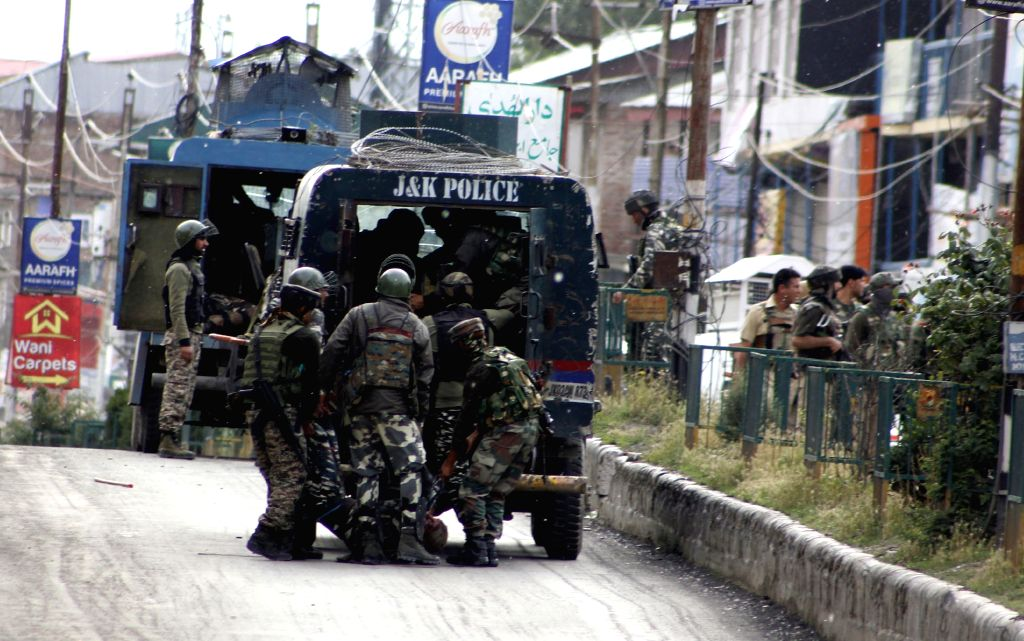 Soldiers at the site where two masked militants in a car attacked a joint party of local police and the CRPF in K.P.Road area of Anantnag on June 12, 2019.