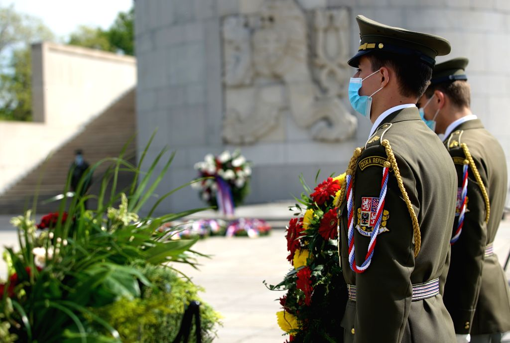 Soldiers attend a wreath laying ceremony at the Tomb of the Unknown Soldier to mark the 75th anniversary of the end of World War II in Europe in Prague, the Czech ...