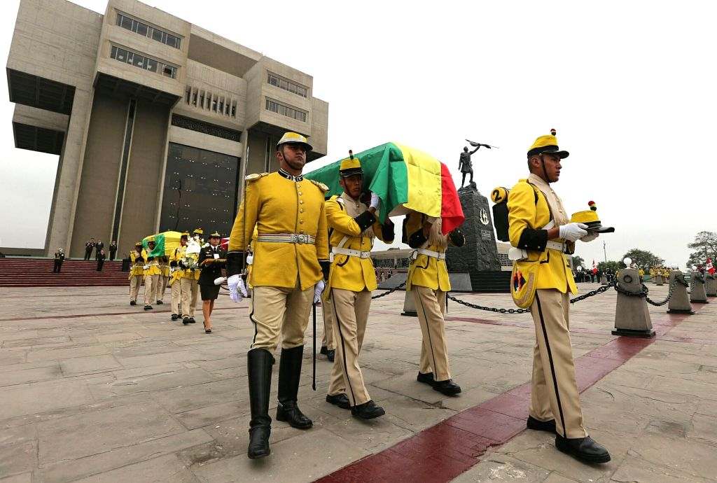 Soldiers carry coffins during the delivery ceremony of the remains of Bolivian soliders that died in the 1879-1883 Pacific War, in Lima, Peru, on Aug. 17, 2015. The ...