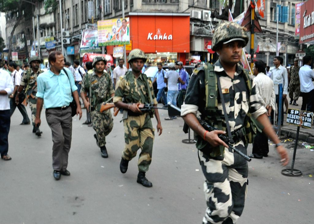 Soldiers conduct a flag march ahead of bypolls in Chowringhee of Kolkata on Sept 10, 2014.