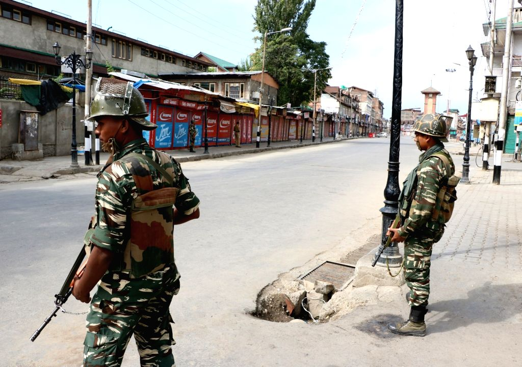 Soldiers deployed on a Srinagar street as curfew continued for the 41st Day in Kashmir on Aug 18, 2016.