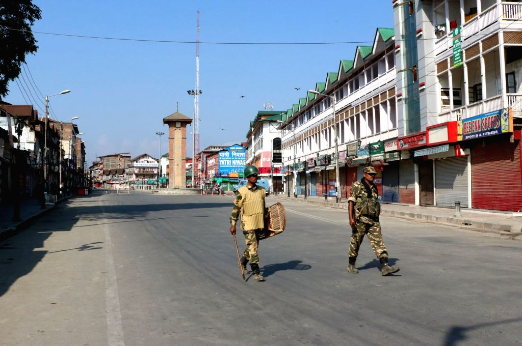 Soldiers deployed on Srinagar road as curfew continues for the 36th consecutive day in Kashmir on Aug 13, 2016.