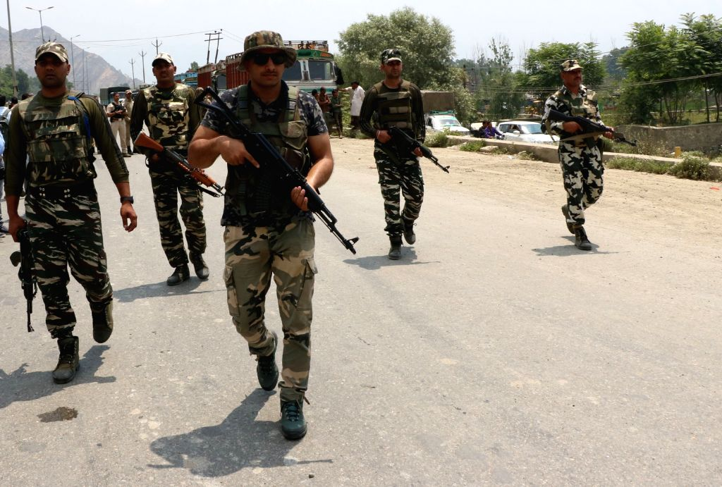 Soldiers during a gunfight between on Sunday between the security forces and militants holed up inside the Delhi Public School (DPS) complex in Pantha Chowk area of Srinagar on June 25, ...