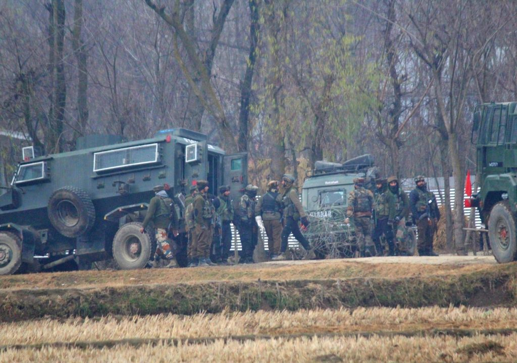 Soldiers during an encounter with militants in Gund Brath village of Jammu and Kashmir's Sopore district on Dec 13, 2018. Two militants were killed and weapons were recovered from their ...