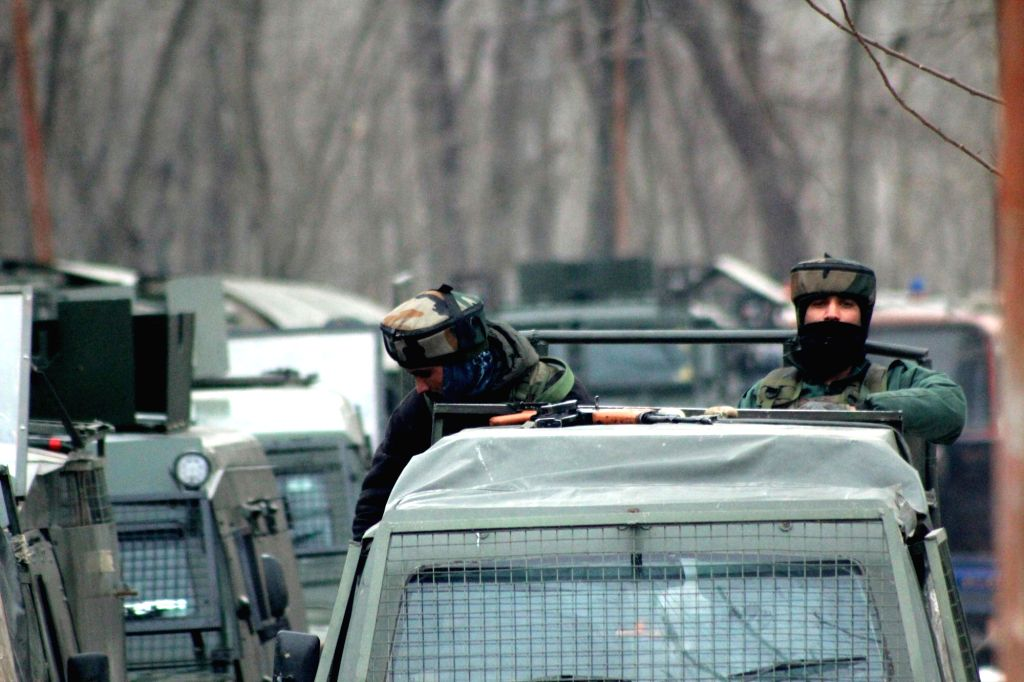 Soldiers during an encounter with militants in Gopalpora village of Jammu and Kashmir's Badgam district on Feb 13, 2019. Two militants were killed.