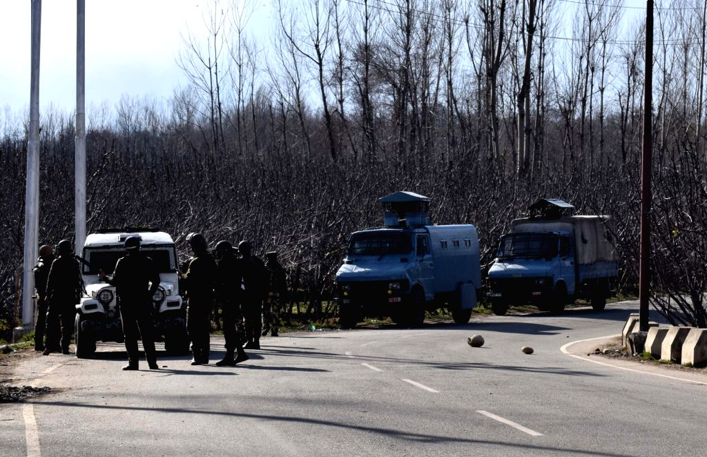 Soldiers during an encounter with militants in which a senior police officer, an Army soldier and three militants were killed at Turigam village in Jammu and Kashmir's Kulgam district on Feb ...