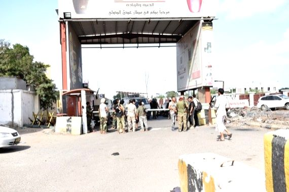 Soldiers gather at the airport's main gate following three explosions rocked the Aden International Airport in Aden, Yemen, Dec. 30, 2020.