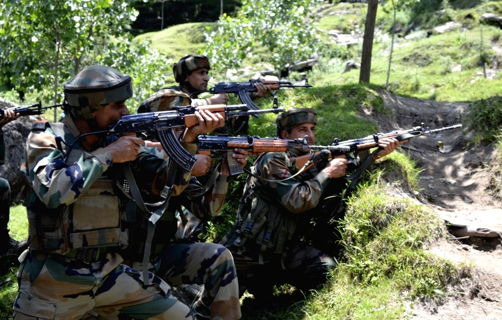 Soldiers in action during an encounter with militants in Baramulla district of Kashmir on June 26, 2016.