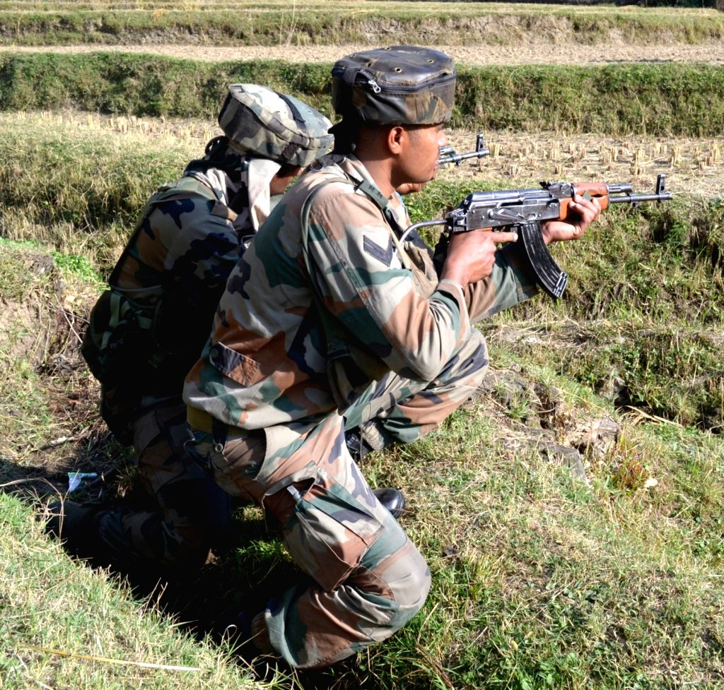 Soldiers in action during an encounter with militants in north Kashmir's Kupwara district on Oct 6, 2016. Three heavily armed Pakistani terrorists dressed in army fatigues who attacked the ...