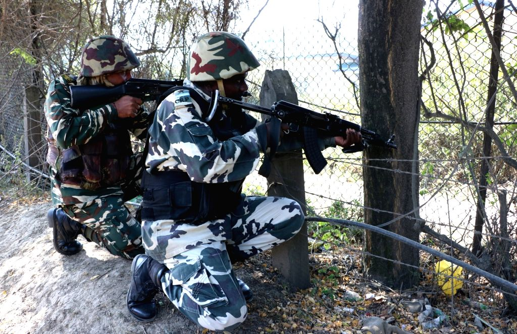 Soldiers in action during an encounter with militants in Pampore of Jammu and Kashmir on Oct 10, 2016. A soldier was injured in the gunfight that erupted after 2-3 militants opened fire at ...